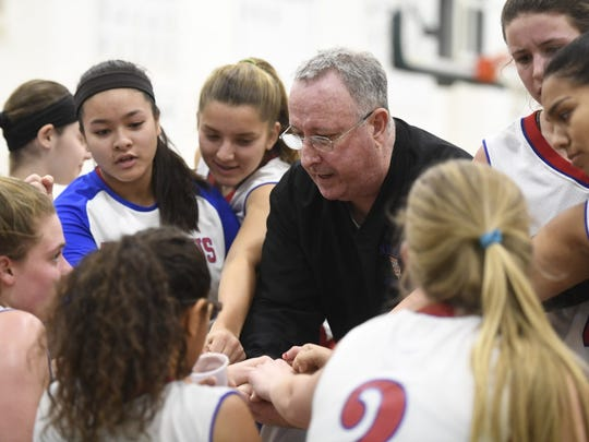 Coach John Sterling draws up a play with his Secaucus girls basketball team during a timeout.