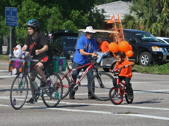 Children riding decorated bicycles in the 2015 Lehigh Spring Festival Parade.