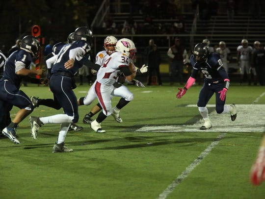 Running back Cole Harriet of Pompton Lakes runs the