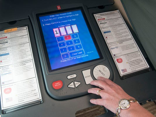 Texas-Tribune-voting-ballot-machine.jpg