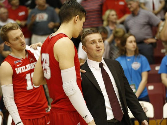 Ethan Whaley, right, climbed the ranks at Indiana Wesleyan, from student manager, director of men's basketball operations, assistant coach and now women's basketball head coach.
