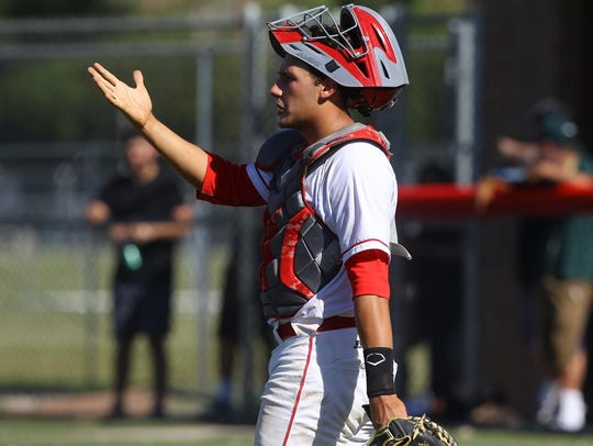 Palm Desert High School, in white and red uniform,