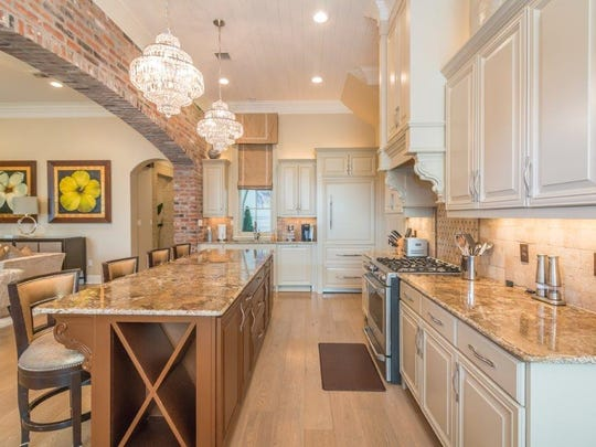 The gourmet kitchen has gorgeous counter tops and designer touches.