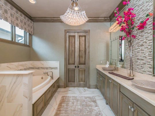 The master bath is a luxurious spa-like retreat.