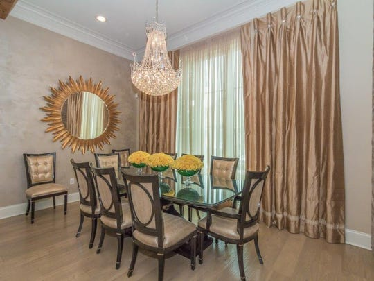 The formal dining room is perfect for any dinner party.
