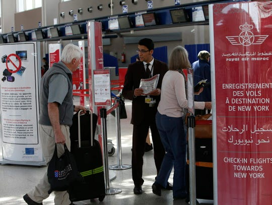 Airport staff inform passengers March 29, 2017, about