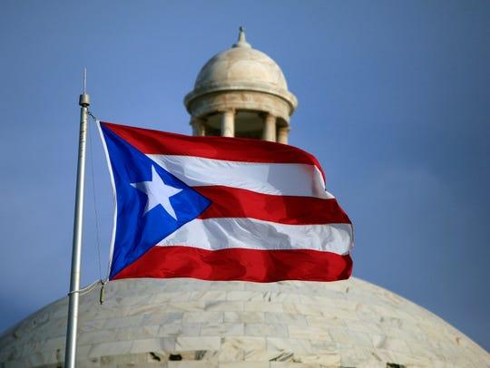 The Puerto Rican flag flies in front of Puerto Rico's