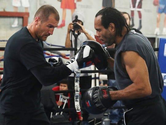 Sergey Kovalev, left, and his trainer, John David Jackson,