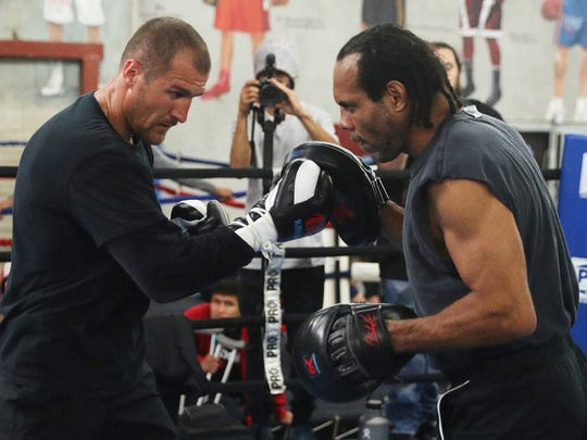Sergey Kovalev, left, and his trainer, John David Jackson, work the mitts during a recent training session.