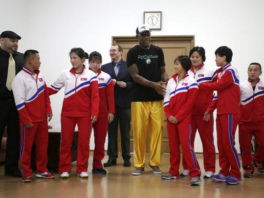 Former NBA basketball star Dennis Rodman, center, poses with North Korean Olympic athletes on June 15 in Pyongyang.