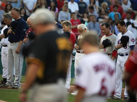 Players participate in a moment of silence during the 56th Annual Congressional Baseball Game for Charity at the Nationals Park.