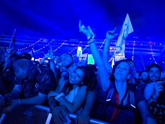 Attendees enjoy Major Lazer's set at Cosmic Meadows on the first night of the Electric Daisy Carnival at Las Vegas Motor Speedway on Saturday, June 17, 2017 in Las Vegas.