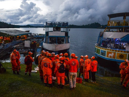 Rescue officials gather to take part in a search for