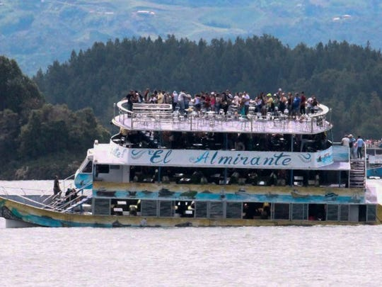 Passengers are seen aboard the tourist boat Almirante