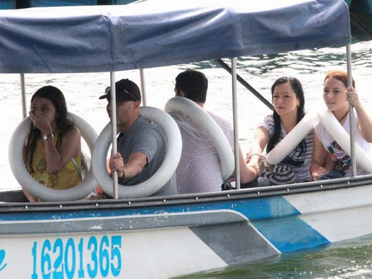 Survivors react after being rescued from the tourist