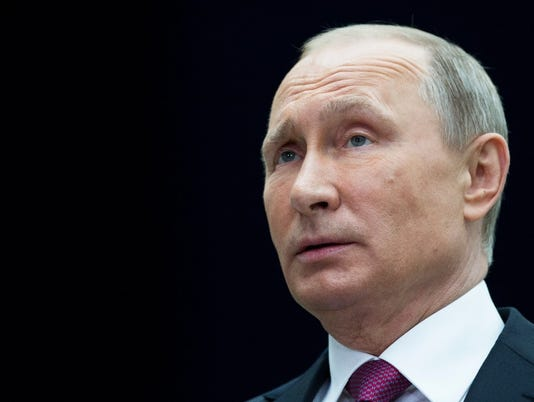 636343358396400796-Putin.JPG