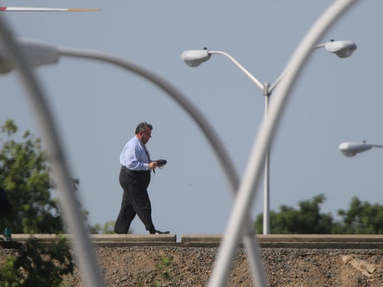 Gov. Chris Christie is shown on a helipad, near John