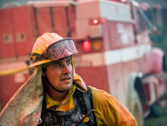 CalFire firefighter Jake Hainey battles a wildfire
