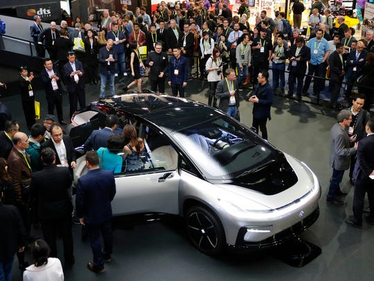 In this Jan. 3, 2017, file photo, Faraday Future's FF 91 electric car is unveiled during a news conference at CES International in Las Vegas.