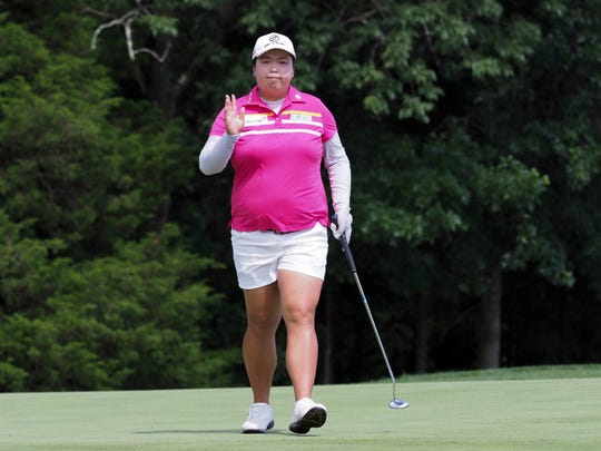 Shanshan Feng of China has the lead after three rounds