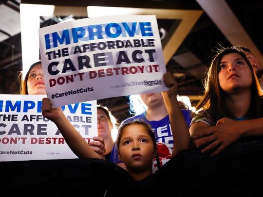 Supporters listen as Sen. Bernie Sanders, I-Vt., speaks