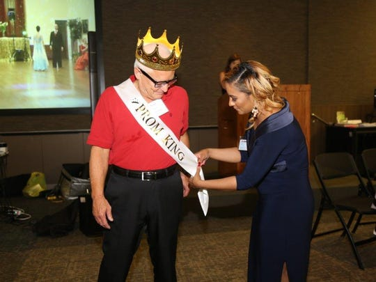 Overlook community health coordinator Alexandra Green crowns Andy Haspel of New Providence as Prom King.