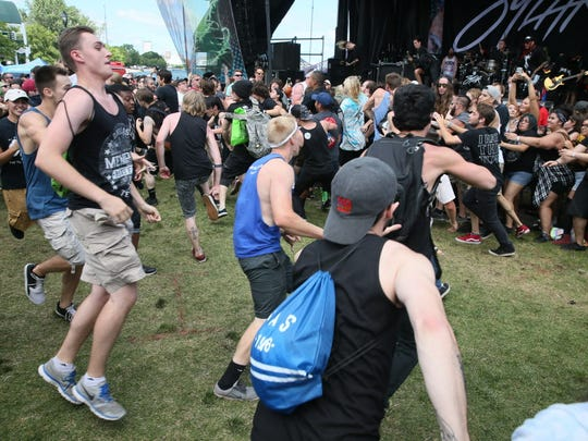 A mosh pit forms as Sylar performs at the Warped Tour's Milwaukee stop Monday.