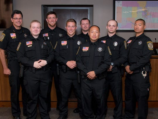 Former University of Wisconsin-Stevens Point and Edgar football standout Aaron Karlen (back row, second from left) was part of the deputy class welcomed to the Marathon County Sheriff's department in a ceremony on July 21, 2017.