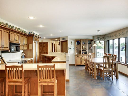 The kitchen opens into an informal dining area at 16861 Diamond Lake Road N in Dayton.
