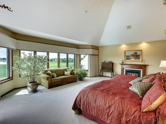 There's room to lounge in the bedroom at 16861 Diamond Lake Road N in Dayton.