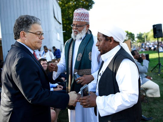 Sen. Al Franken shakes hands with Sa'ad Musse Roble, center, with the World Peace Organization, and Omer Abdi Nur, visiting from Michigan, after Franken spoke at a rally at Dar Al-Farooq Islamic Center in Bloomington, Minn. The suburban Minneapolis mosque was bombed Saturday, Aug. 5 as worshippers were about to start their morning prayers. No one was hurt in what Minnesota's governor has deemed a terrorist attack.