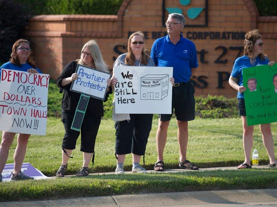A small group of protesters gather outside an event where Sen. Rand Paul will speak to supporters during The Champions of Liberty Rally in Hebron, Ky., Friday, Aug 11, 2017. Sen Rand will be joined at the fundraising event by Kentucky Gov. Matt Bevin, and U.S. Reps Thomas Massie, R-Ky., and Rep. Jim Jordan, R-Ohio.