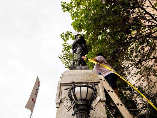 636383766498775287-Confederate-Monument-Protest-Statue-9-.jpg