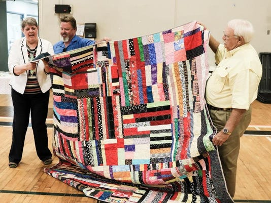 Quilt-presentation-to-US-Navy-Desert-Storm-veteran-Robert-Thomas-Beverly-Randolph-Robert-Thomas-Rick-Vaughn.jpg