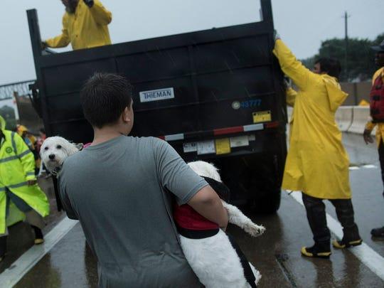 Houston city workers prepare trucks to evacuate residents