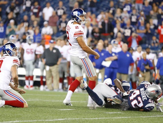 New York Giants kicker Aldrick Rosas (2) watches his