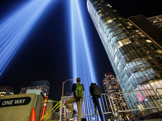 People gather on a rooftop as the 'Tribute in Light'