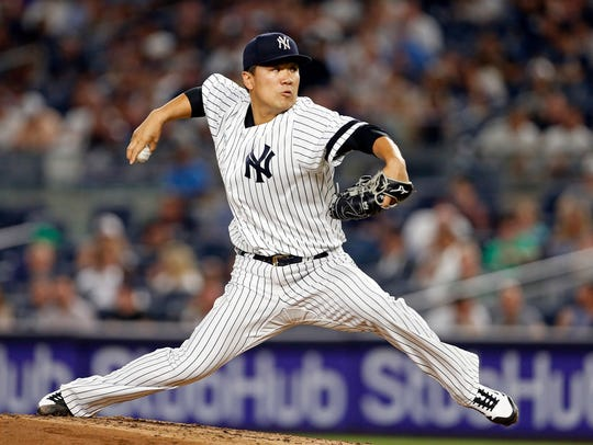 Yankees starter Masahiro Tanaka delivers a pitch against