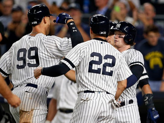Aaron Judge (99) celebrates with Jacoby Ellsbury and