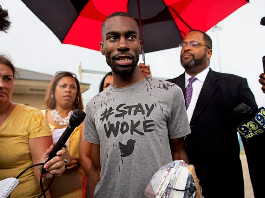 In this July 10, 2016, file photo, Black Lives Matter activist DeRay Mckesson talks to the media after his release from the Baton Rouge jail in Baton Rouge, La. A federal judge has ruled, Thursday, Sept. 28, 2017, that Black Lives Matter is a social movement that can't be sued over an officer's injuries during a protest following a deadly police shooting in Baton Rouge last year.