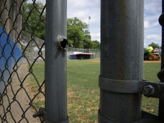 A bullet hole is seen on a gate at the Eugene Simpson Stadium Park, the site where House Majority Whip Rep. Steve Scalise was shot  June 14, 2017,  in Alexandria, Va.