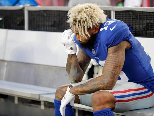 New York Giants wide receiver Odell Beckham (13) reacts on the bench during the fourth quarter against the Tampa Bay Buccaneers at Raymond James Stadium.