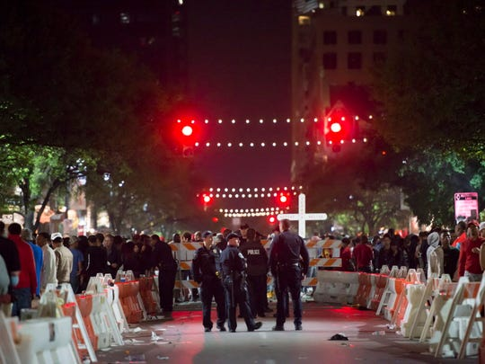 Austin Police keep an eye on the crowds from a cordoned-off