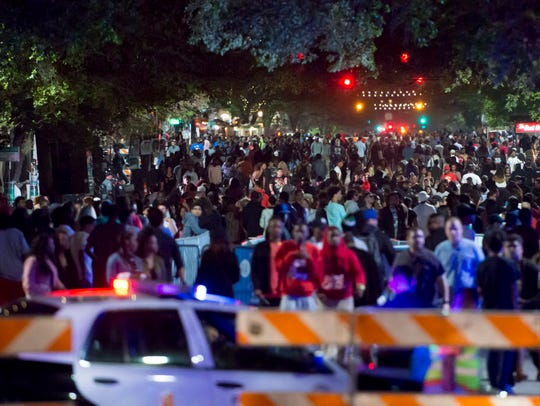 Crowds wander up and down 6th Street in Austin during