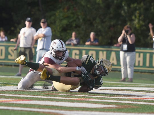 St. Joe's TE Matt Alaimo cradles the game-winning touchdown catch against Don Bosco Saturday.