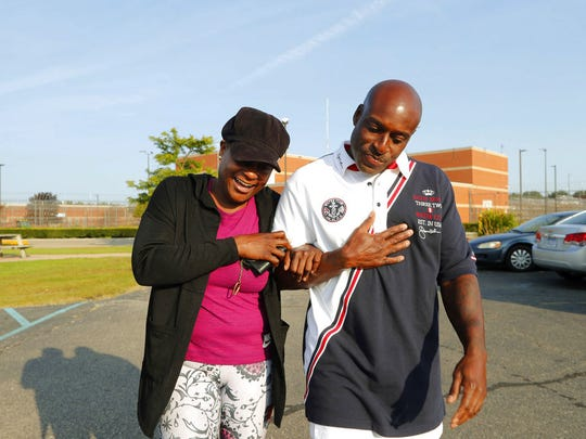 Bobby Hines leaves the Macomb Correctional Facility with his sister, Myra Jessie, in New Haven on Sept. 12.