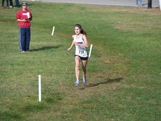 Corinne Barney of Indian Hills en route to second place finish in North 1, Group 3.
