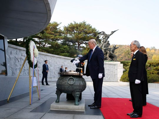 President Trump burns incense during his visit to the