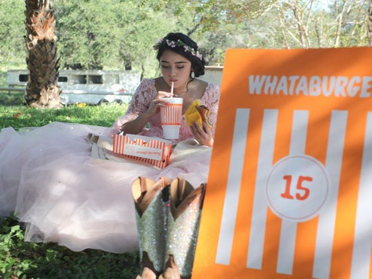 Lopez Terrazas is seen eating Whataburger during her quinceañera session.