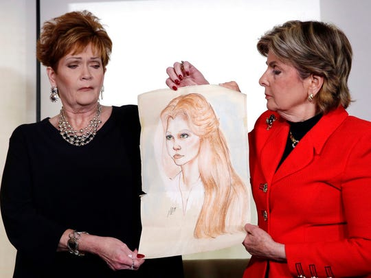 Beverly Young Nelson, left, the latest accuser of Alabama Republican Roy Moore, and attorney Gloria Allred hold a sketch of Nelson at age 16, during a news conference, in New York, Monday, Nov. 13, 2017.